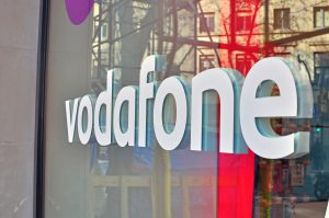 37132796 - barcelona, spain - february 5: logo of vodafone company in the shop on february 5, 2015. vodafone is a british multinational telecommunications company.